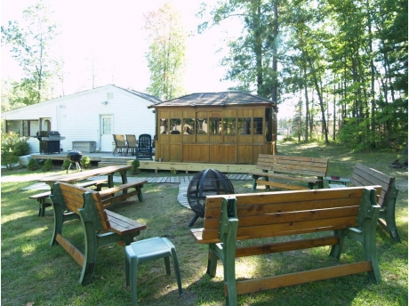 Large Backyard with Benches, Picnic tables, Fire Globe, Hot Tub, Wooden Walkways, Deck, 2 BBQ's, Rockers