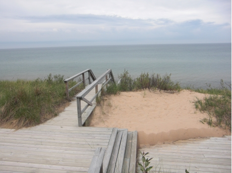 Wooden walkway down to the beach. Handrails on both sides make it safe and easy.