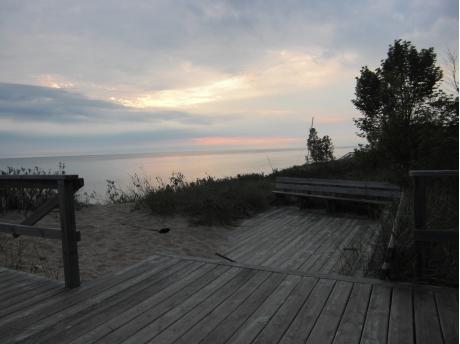 Watch sunset here at community beach deck.