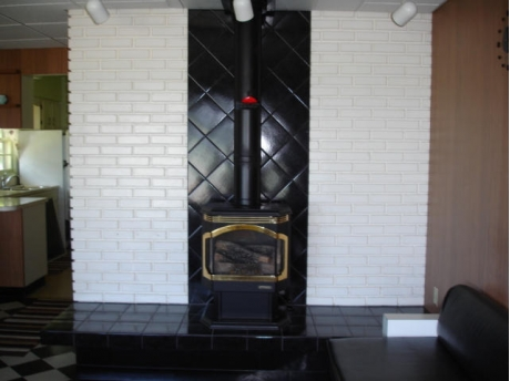 green cottage fire place