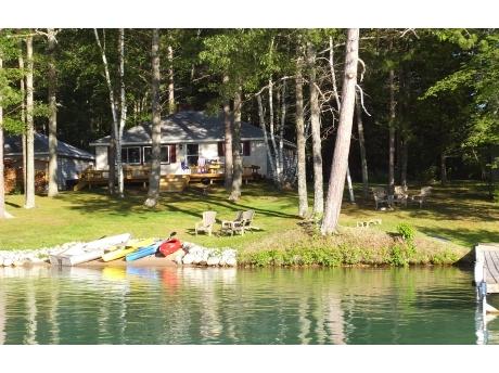 Enjoy sandy beach, dock, 2 of the kayaks and an aluminum boat