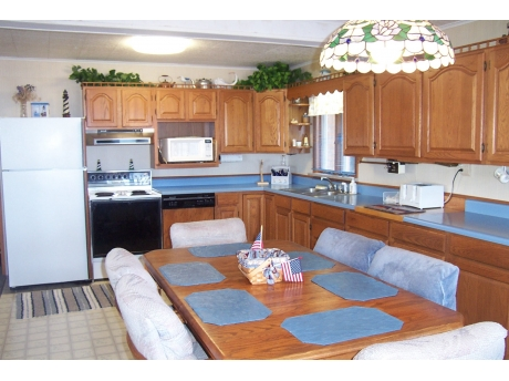 Large Kitchen that also faces the water and opens to the sunroom and living room