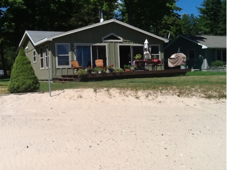 Sandy beach to play with sand toys and fire pit as you watch freighters sail up and down the lake