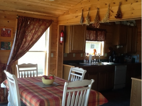 Kitchen table seats six and has great views of Lake Huron ...steps to the beach