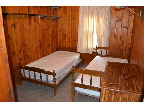 One of two similar bedrooms