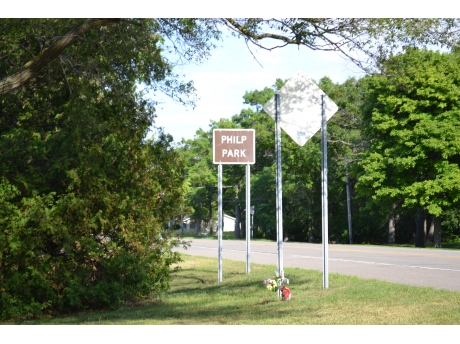 Philp Park historic road sign on M-25