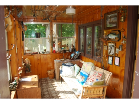 Enclosed porch with swing