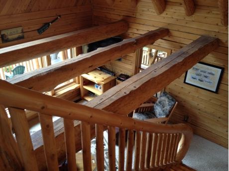 Looking down into living area from open loft.