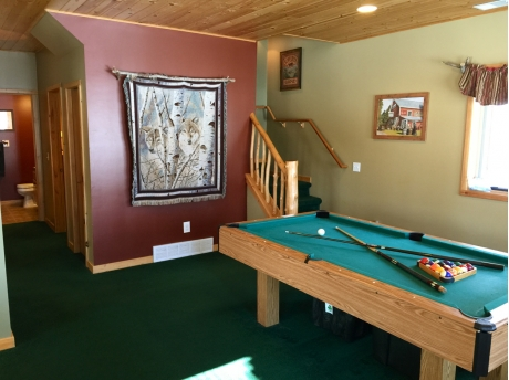 Second living room with pool table and PS2 (so kids don't wake you up with early Saturday morning cartoons on vacation.)  :)