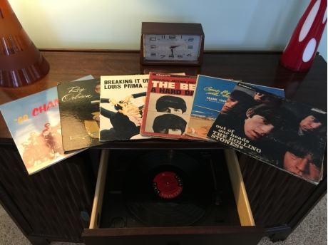 60s collection of vinyl with working turntable.
