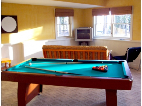 Second Living room with pool table and PS2 so kids can have fun too.