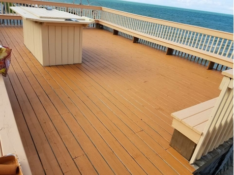 spacious deck with built in seating and high top island