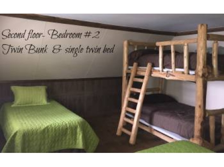 Bedroom upstairs has a Queen, Twin, & Full size bunks