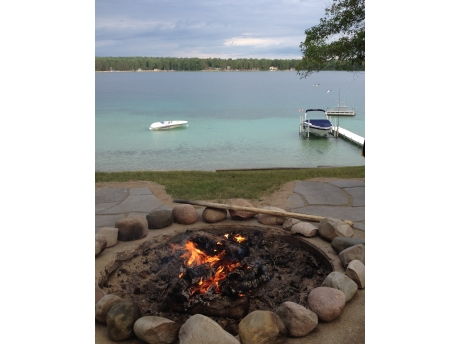 Bonfire pit and a view of your boat moored on the lake.