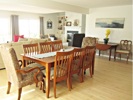 Bright and open living and dining room just off open kitchen