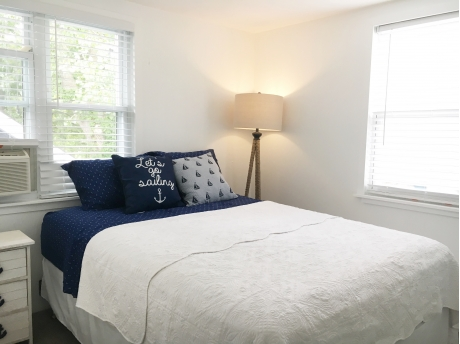 Bedroom with Queen Size bed and Window AC