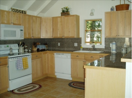 Well-equipped modern kitchen with dishwasher, full size fridge, microwave, coffee maker, Keurig