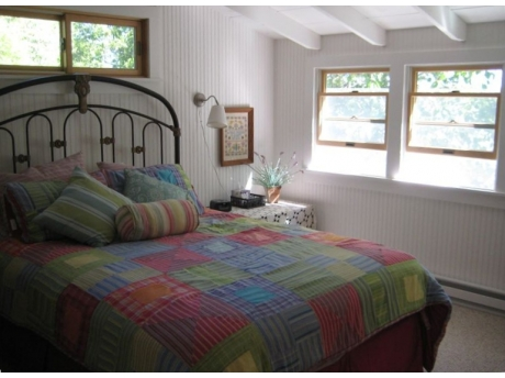 Upstairs master bedroom with lake view and window AC