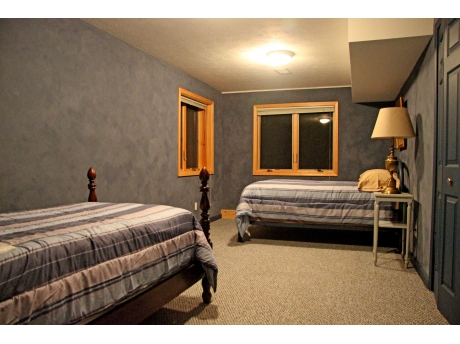 Lower Level Bedroom with Queen and Twin Beds