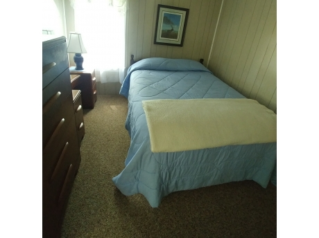 Comfortable Bedroom, with pillow top mattress Dresser's and open closet.