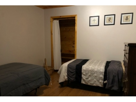 Bonus area centrally located in home with two twin beds.