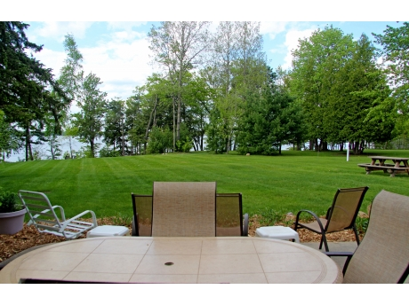 Looking from the home to the bluff overlooking the lake.