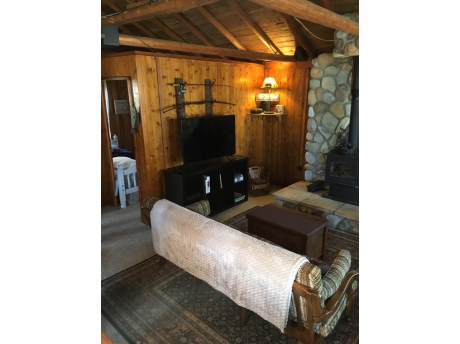Brand new wood stove for those cold nights early or later in the season. Brand new 4k 50 inch smart TV with Dish network service and also connected to WiFi. Living room has couch, 2 futon chairs and b