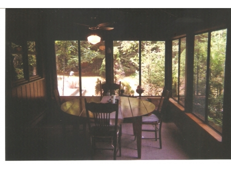 Screened Porch with round table
