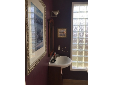 Bathroom with shower in master bedroom.