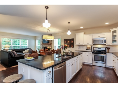 Kitchen features a large island and gas range