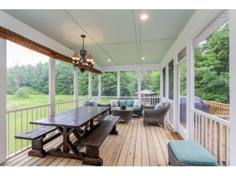 Screened deck with living and dining areas
