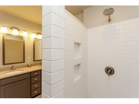 Master bathroom with walk in shower and double vanities