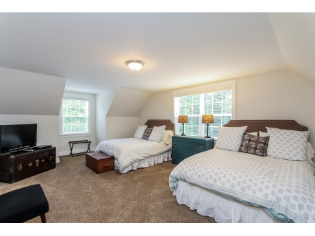 Huge upstairs bedroom with two queen beds and 42