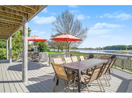 Lower Level Deck with Outdoor Furniture overlooks the water and sunset views