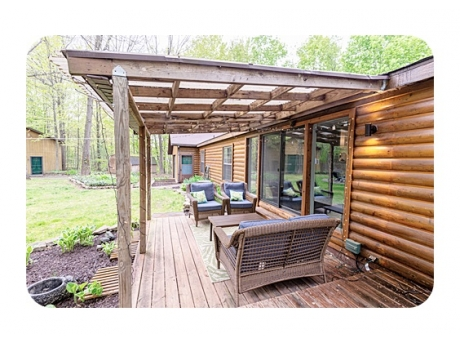 Great Outdoor Space with Covered Deck Overlooking the Backyard