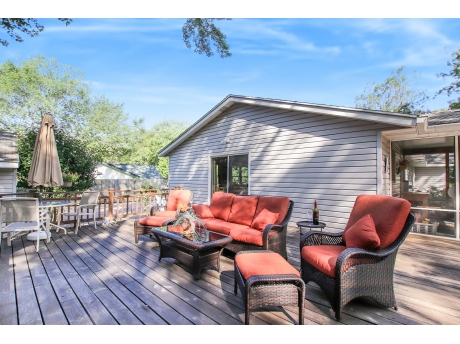 There is both Dining and Lounging Space on the Extra Large Deck Overlooking the Backyard