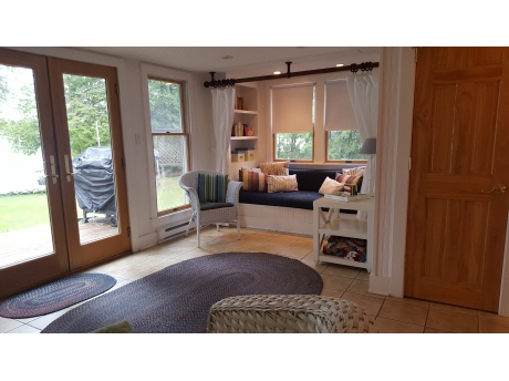 The first floor daybed provides a cozy reading nook and extra sleeping space.