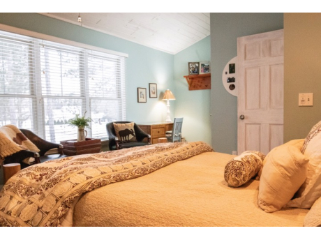 Loft Bedroom has large windows with view of towering red pines!