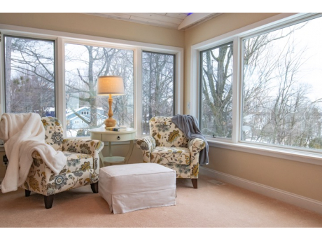 Sitting area is perfect for reading, knitting or daydreaming while looking at marina and Lake Charlevoix!