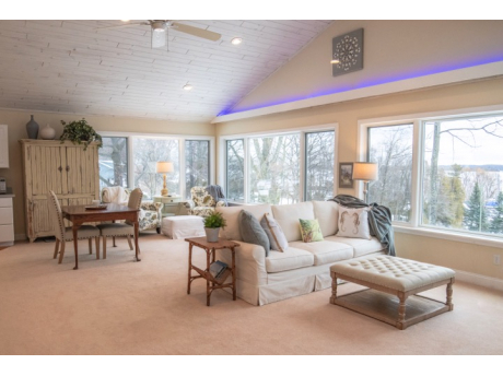 Spectacular view of Lake Charlevoix awaits you in our spacious living room with vaulted ceilings, library and game cabinet, kitchenette.