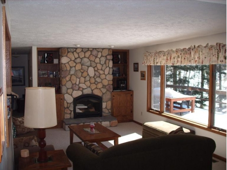 Stone fireplace with a fantastic view of the beach!