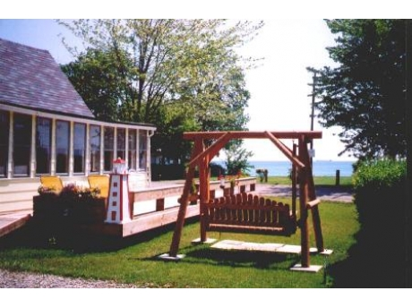 Sailaway Cottage with wrap around deck looks directly at Lake Huron