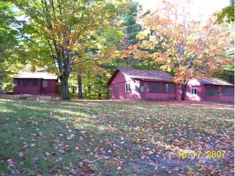 Cabins #1 and #2 with Cabin #3 on top of the hill
