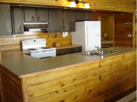 Roomy, modern kitchen overlooks the water