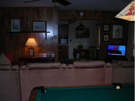 Living Room with view of pool table & flat screen TV