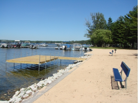 Sandy beach area and swim dock